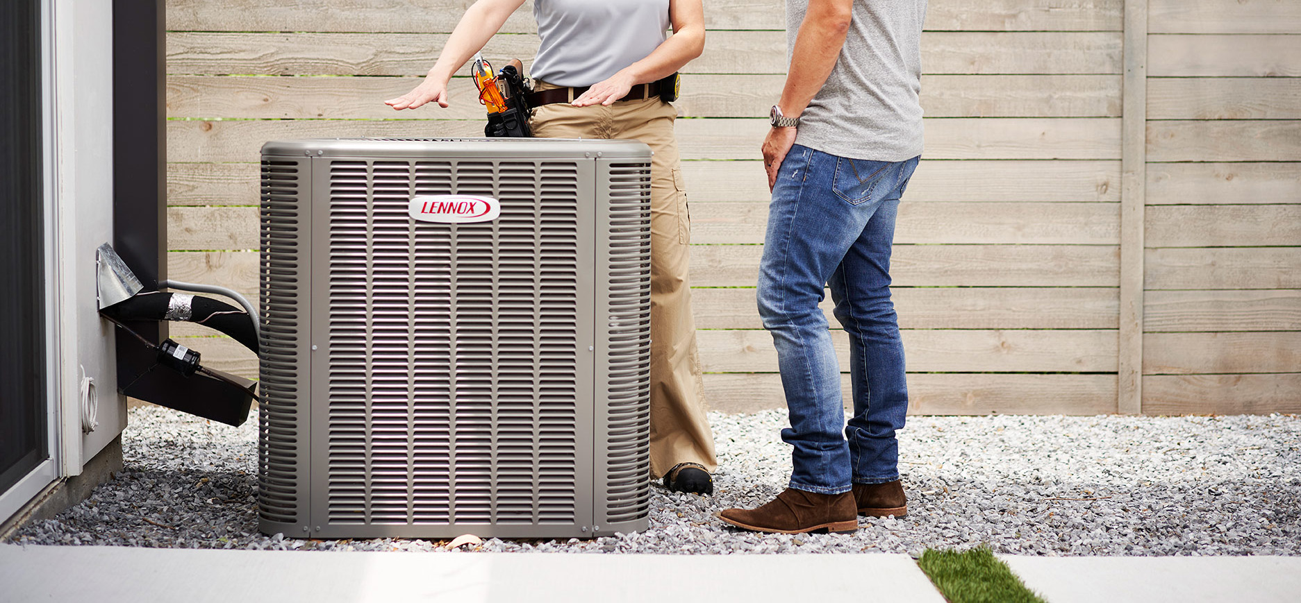 HVAC Technician and Owner next to Lennox HVAC system